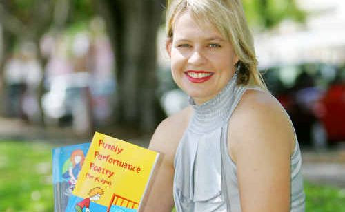 Kylie Weston-Scheuber with her books Purely Performance Poetry and Purely Performance Poetry Volume Two.