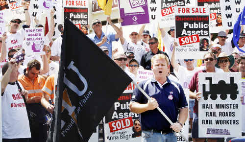 Jason Young, state organiser of the ETU leading the protest yesterday against the sale of Queensland public assets.
