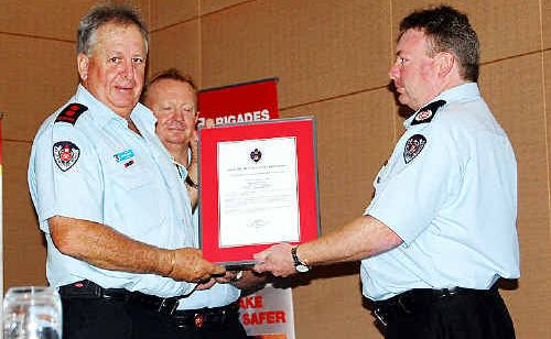 FLOOD THANKS: Ballina station commander Captain Dennis Henry (left) receives an award from the director of regional operations,Assistant Commissioner Jim Hamilton. The awards were held in the Ramada, Ballina, on Saturday.
