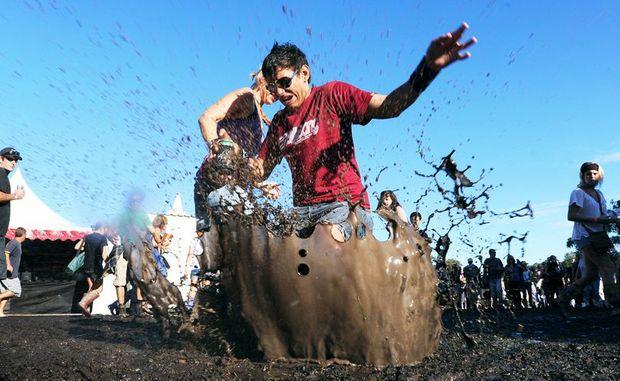 Sera Haewera and Matthew Pratt have some fun in the mud.