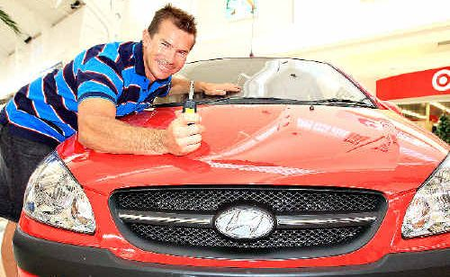 Peter Prestage with the Hyundai Getz he won on the weekend in a Tweed Centro promotion.