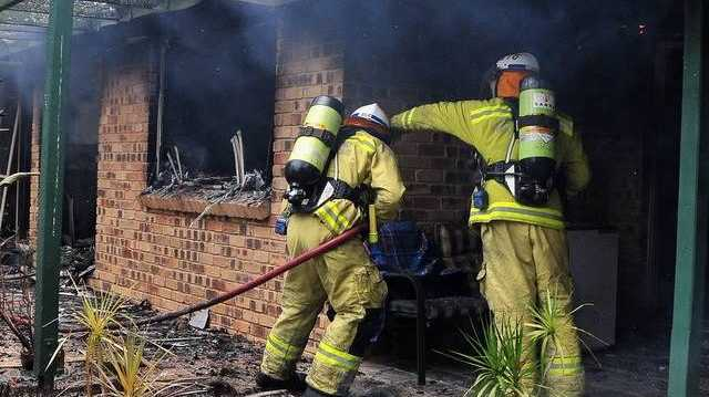 Firefighters battle a blaze which damaged a home at Misty Lane Cooroibah.
