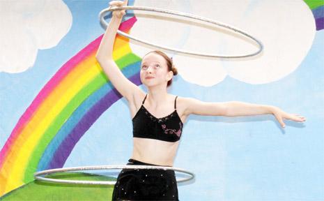 PICTURED is Kyaisha Ellbourn performing her hoop-dance routine. Photo: Jocelyne Pegoretti.
