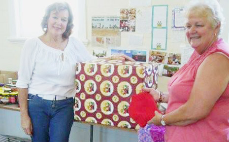 Brunswick Valley VIEW Club President Margaret Alderton (right) handed over a large Christmas hamper and dozens of hand-knitted items to Anne Thompson, organiser of the North Coast Drought Appeal.