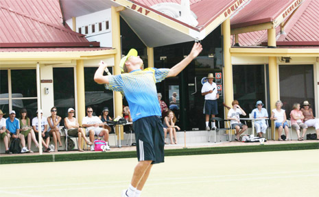 PICTURED is Stephen Gort serving on the makeshift grass tennis court at the bowling club on Sunday.