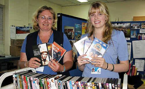 Trudy Haack and Melissa Jones from Gympie Library with some new DVDs.