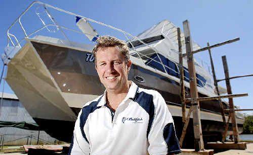 Sailfish Catamarans director Darren Foster with the Enforcer, a 15-metre aluminium twin-hull luxury cruiser-cum-fishing boat built at his Alstonville factory.