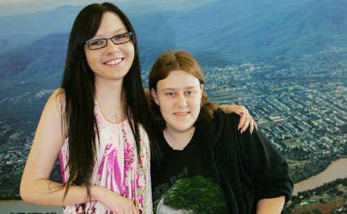 Rockhampton teen Emmy Clark welcomes her Canadian pen pal Laura Bowman at Rockhampton airport.
