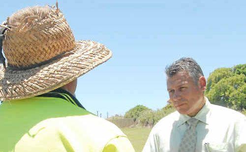 Concerned father talks to Member for Burnett Rob Messenger about his daughter's dental care at Bundaberg Hospital.