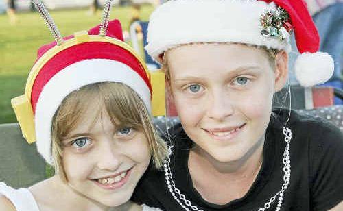 Regan and Sarii Caldwell looking forward to singing along at Carols by Candlelight.