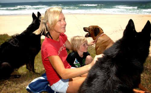 Samantha Daley, her son Jackson, 7, and her three dogs at Dump Beach between Flat Rock, Yamba, and Greenpoint, Angourie, where the incident took place.