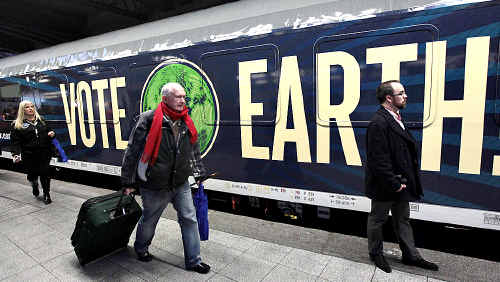 Passengers arrive to catch train Clima Express, which takes envoys to the climate summit.