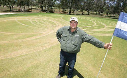 Bundaberg Golf Club greenkeeper Mark Wooldridge stands on the green that hoons tore up twice on the weekend.