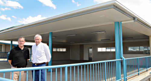 The new roof over the top floor of the Bill Bishop building at the Showgrounds is a gift to the community says Show Society president Graham Engeman, pictured (right) with Turf Club president Spencer Slatter.
