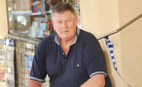 Bangalow Newsagency courier Steve Dengate was confronted early yesterday morning by a machete-wielding burglar demanding money.