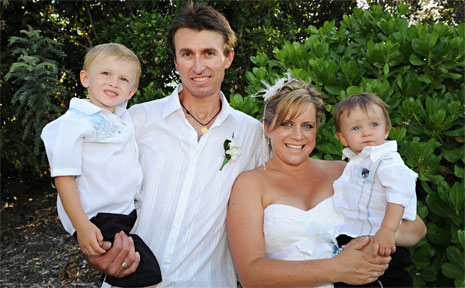 Steve May, with his wife Mel and children Thomas, left, and Jackson. Steve lost his arm in a fishing accident.