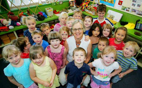 Kindergarten teacher Penny Palmer, surrounded by her two-day group at Leichhardt Community Kindergarten, is retiring after 37 years.