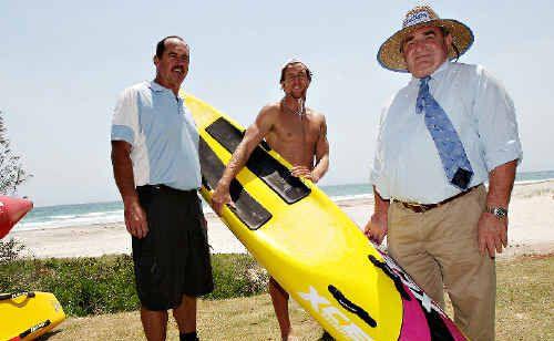 Cudgen Surf Life Saving Club president Garry Cain, athlete Scott McCartney and Tweed Shire Mayor Warren Polglase celebrate the club's successful bid to host the 2011/12 NSW Surf Life Saving Championships.