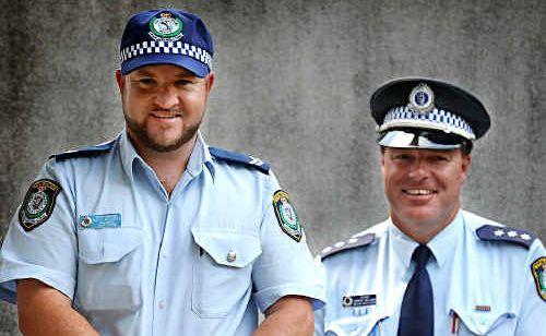 New Wooli police officer Senior Constable Matt Hegarty, left, with former Wooli officer Acting Inspector Darren Williams.