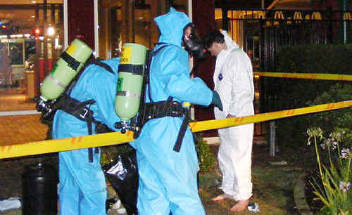 The Casino Fire Brigade Hazmat team in the process of decontaminating staff and the surrounding area at the McDonald's restaurant in Casino on Monday night.
