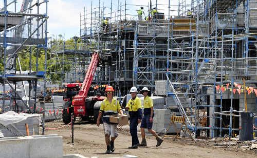 Tradesmen at work on a Coast construction site. The government has approved $2.75 million for a building and construction trade training centre at Caloundra High.