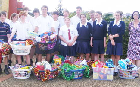 GENEROUS: Students from Xavier Catholic College with the hampers they collected for the St Vincent de Paul Society.