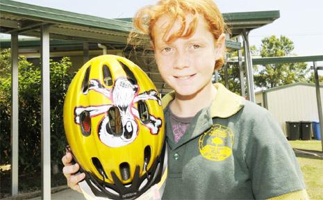 HELMET DESIGN: Ebonie Cooper with her helmet she designed.