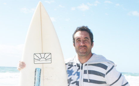 Rescued surfer Kevin Stickl of Byron Bay is very happy to be back on dry land after being rescued.