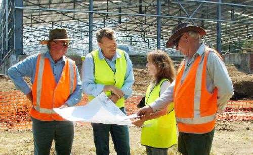 Inspecting plans for the new $8 million Hurford Hardwood Pty Ltd timber mill at Kyogle yesterday are (from left) Hurfords forester, Warren Weaver, Hurfords managing director Andrew Hurford, Federal Page MP Janelle Saffin and Rob Hurford.