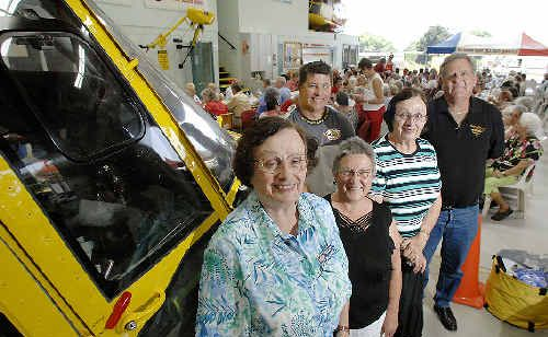 Volunteer fundraisers honoured yesterday by the Westpac Life Saver Rescue Helicopter Service included (from left) Emily Betteridge, of Lismore, Lizzie Wratten, of Junction Hill, Mary Betteridge, of Lismore, and Ken Jolley, of Lismore, who received 25-year service medals, and crewman Mick Kerry, who received a Civilian Emergency Service Personnel National Medal for 15-plus years service.