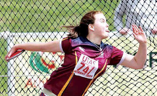 Milli Stuurop hurls her way to the under-14 discus title in Hobart.