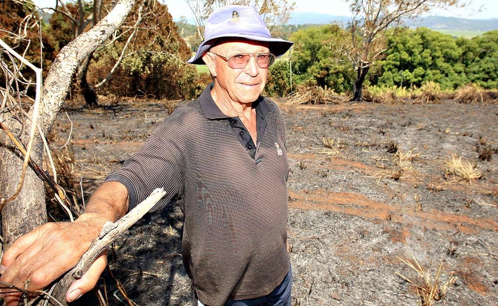 John Brinsmead at the scene of a fire which destroyed three acres, just 50 metres from his house at Duranbah.