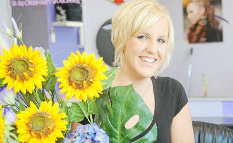Kristy Leigh Devitt, from Sunflowers Hair Beauty and Tanning, wins the Chamber of Commerce Customer Service Award.