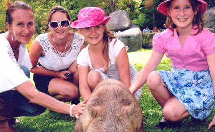 Sherida Parker and daughters Rhiannon, Marie and Kyra enjoy a close encounter with a wombat.