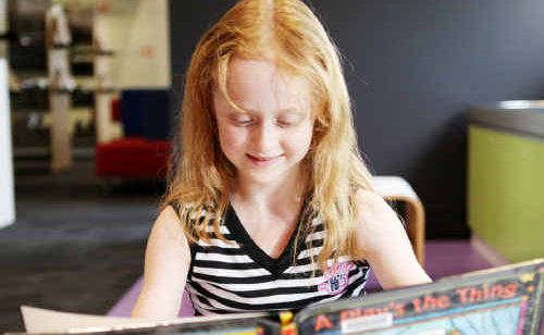 Rockhampton's Danielle James enjoys reading a book at the city's main library yesterday.