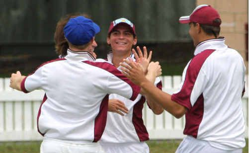 Brothers fieldsmen celebrate the fall of a South wicket at Ellem Oval on Saturday.