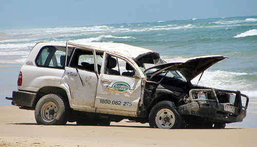 The wrecked 4WD after the rollover on Fraser Island yesterday when a Japanese tourist died.