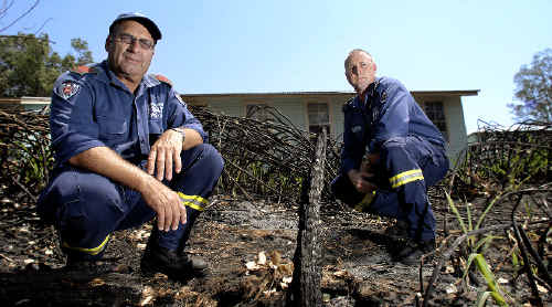 Firefighter Col Bennett (left) and Casino fire station commander Glen Whitehead at the scene of a fire that broke out near the boundary of Casino Primary School.