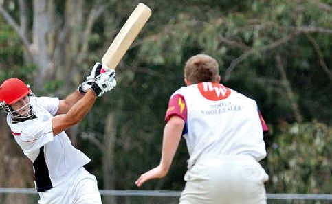 Maroochydore batsman Alecz Day, who top-scored on 79, smashes Tewantin-Noosa spin bowler Elliott Green for six at Buderim.