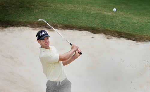 Scott Strange leads the Australian PGA Championship midway through the opening round.