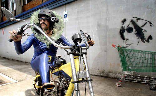Performance artist Mark Shorter, aka Tino La Bamba, has travelled from Sydney to Lismore riding Platanito, or his little banana, as he affectionately calls his motorist bike.
