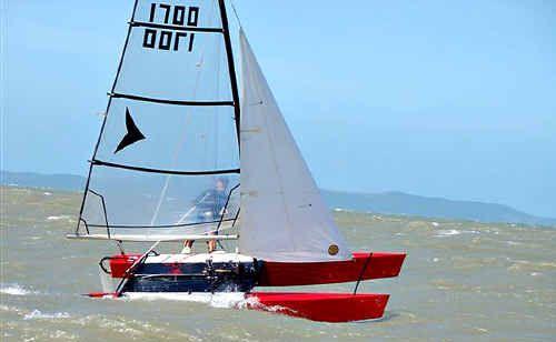 Robert Lea guides his catamaran Wild Child through a swell.