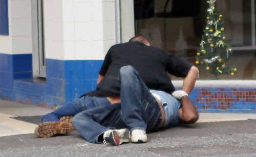 A fight between two men on Denham Street yesterday.