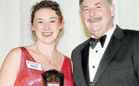 STAR: Sara Dent receiving her award from St George Bank CEO Greg Bartlett.