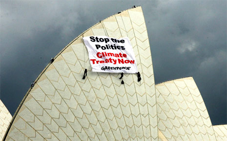 Environmental protesters, including Byron Bay activist Emma Briggs, hung a banner from the iconic Sydney Opera House on Tuesday.