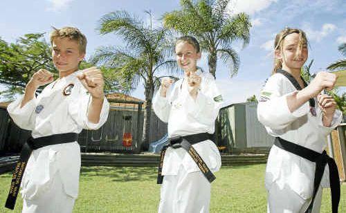 Xander Huhsamen, Stephanie Pole and Kayla Hochmuth celebrate the attainment of black belt status.