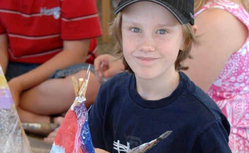 There is no shortage of demand for lantern makers. Thomas Gordon, 8, of Yamba, at the markets. A workshop for youth in the New Year will show how to make them.