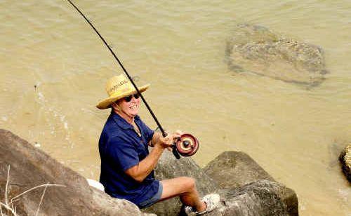 Col Howard, of Yamba, fishing on the Yamba Breakwall.