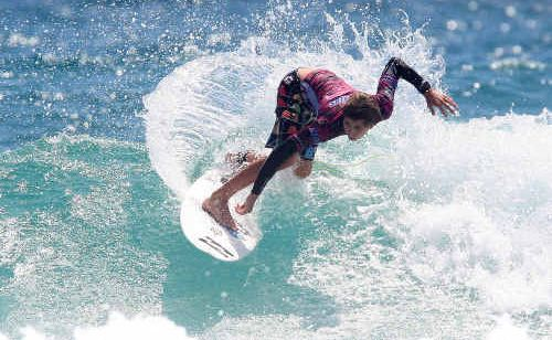Angourie's Jeames Young smashes his rivals at the Rip Curl GromSearch at Duranbah Beach on the Gold Coast yesterday.