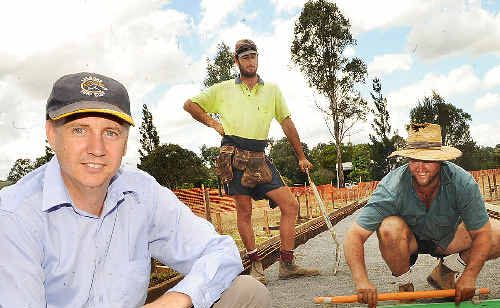 Lismore Turf Club secretary-manager Michael Timbrell (left) at the new tie-ups being constructed by concreters Matt Brunsdon (centre) and Alan Campbell.